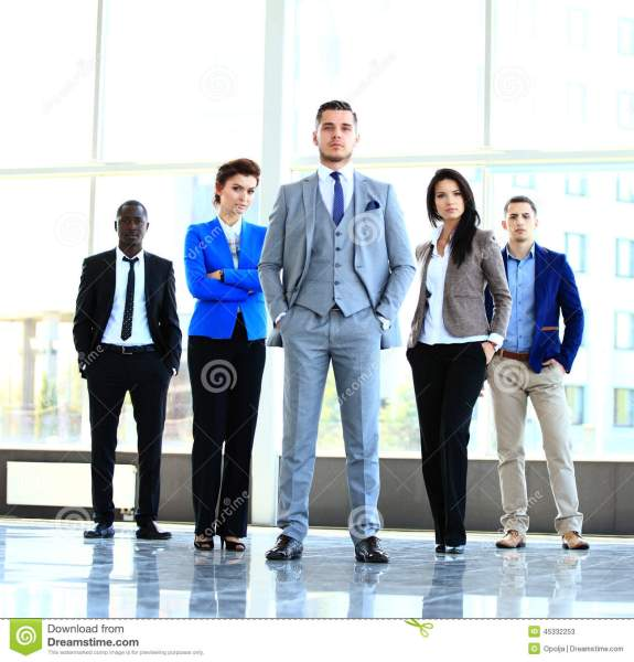 Group Portrait Of A Professional Business Team Looking Confidently     Download comp