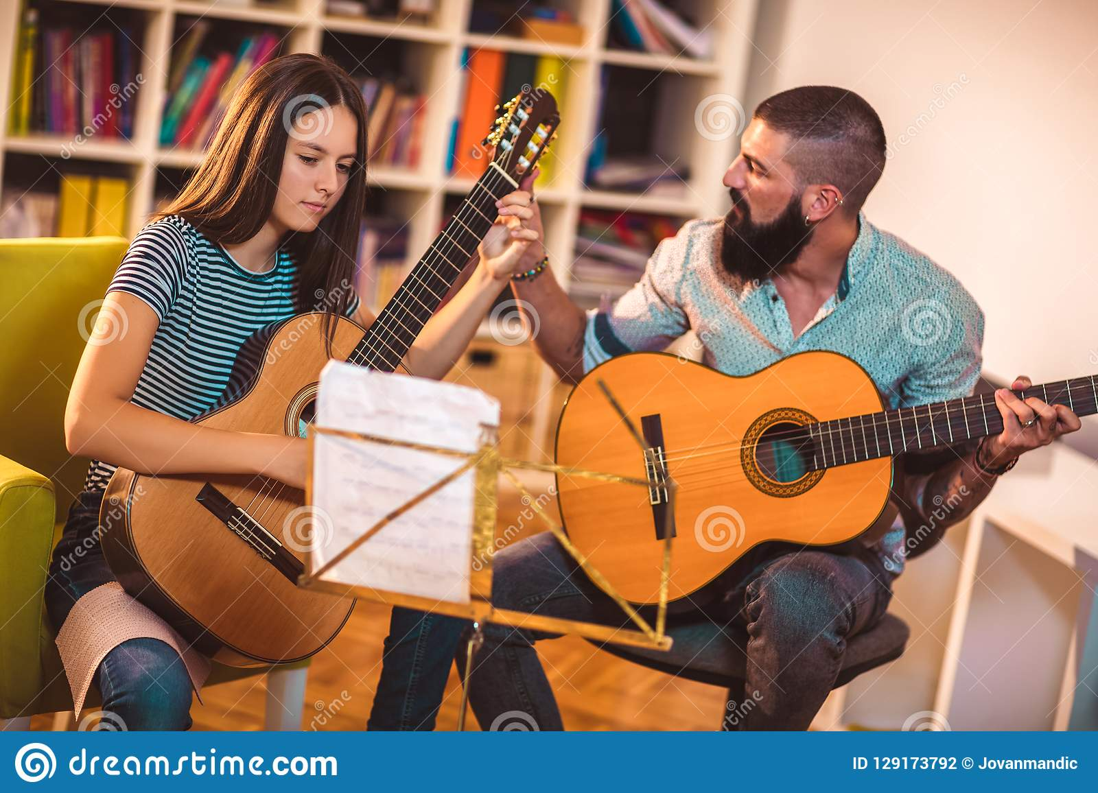 Guitar Teacher Teaching The Girl Stock Photo