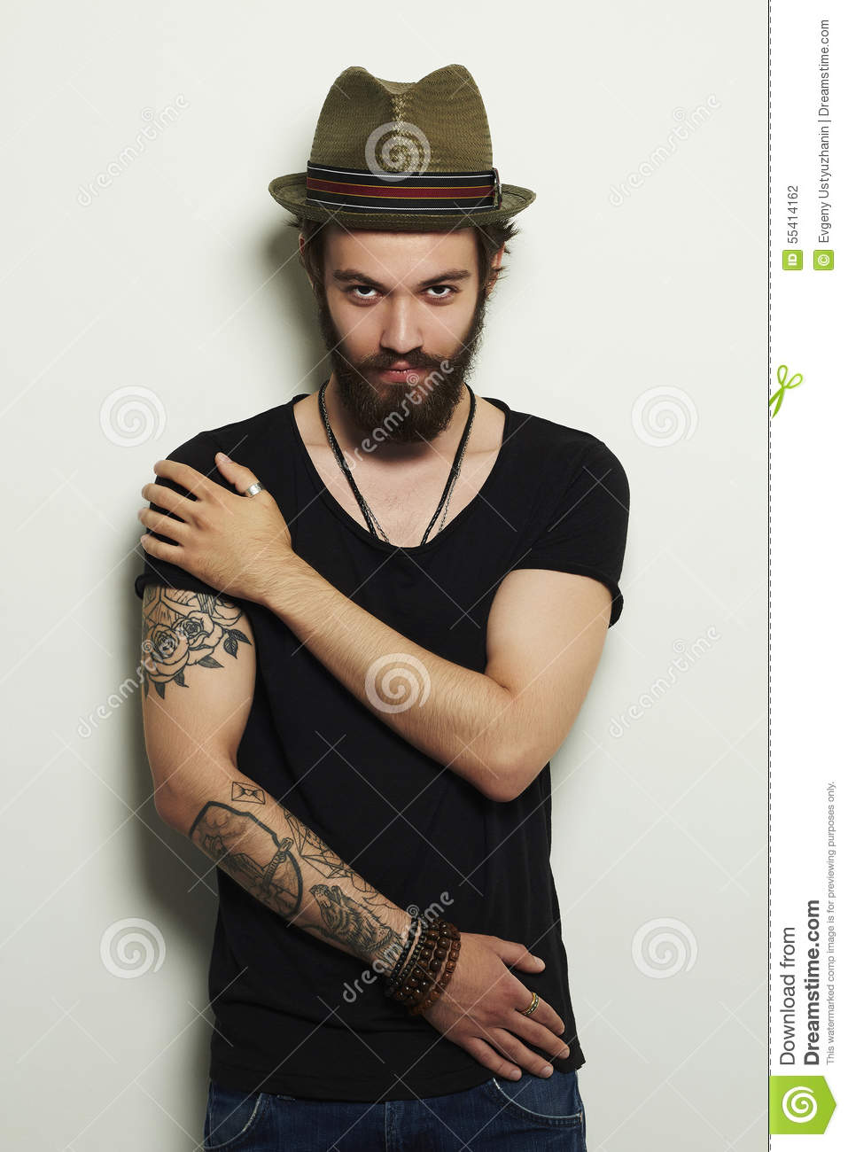 Handsome Bearded Man In HatBrutal Boy With Tattoo Stock