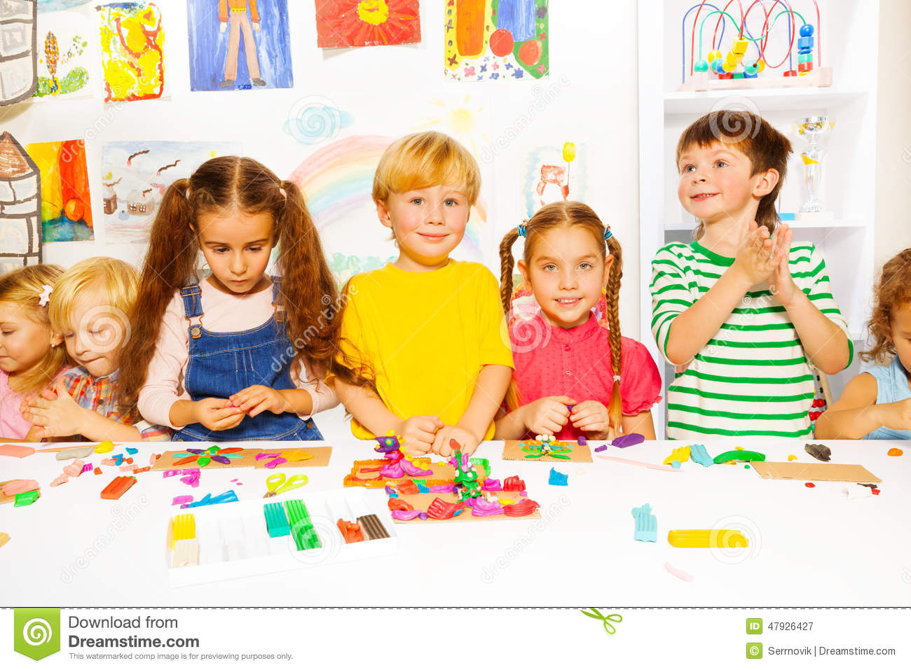 Happy Boys And Girls With Plasticine In Classroom Stock