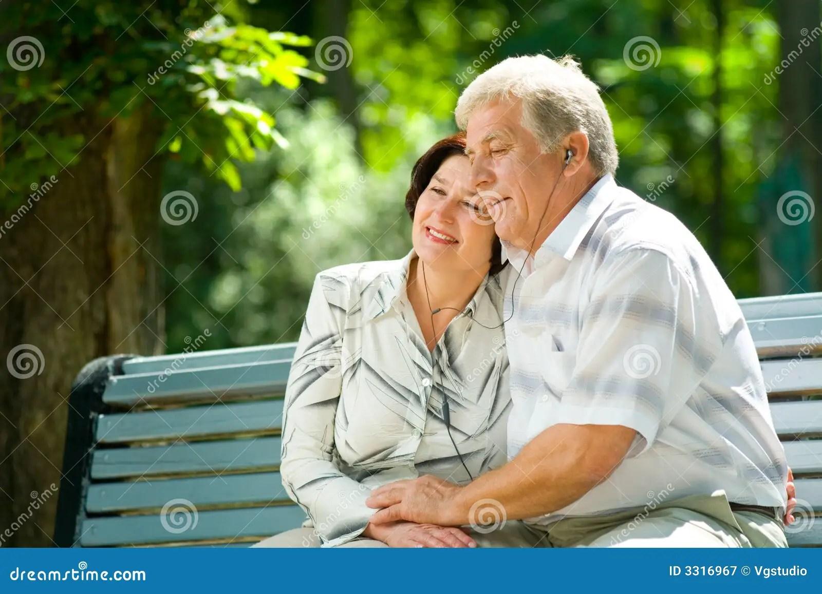 Happy Elderly Couple Outdoors Stock Image