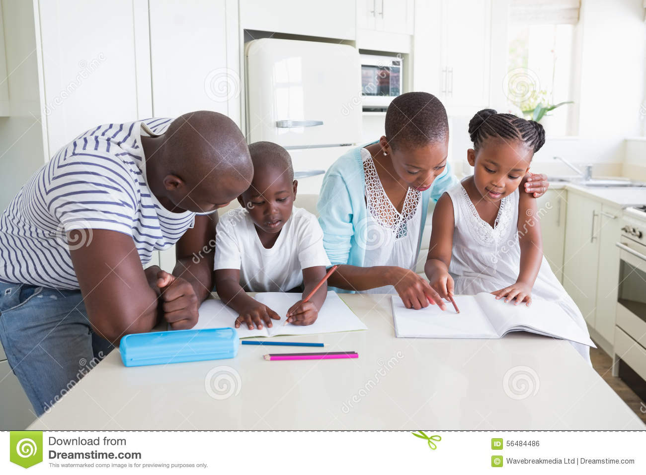A Happy Family Working Together Stock Photo
