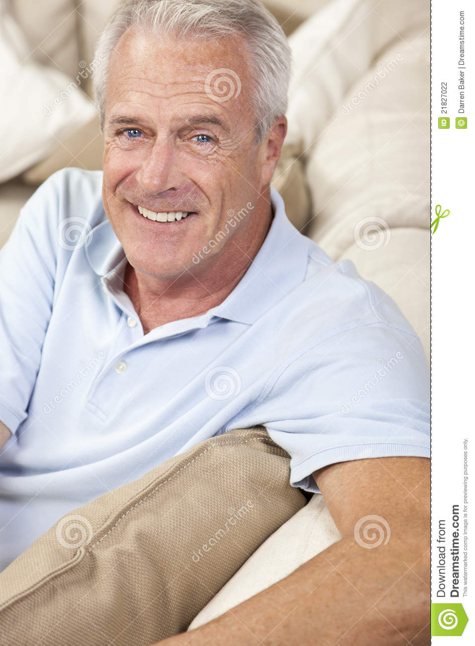 Happy Handsome Senior Man Smiling At Home Stock Photo