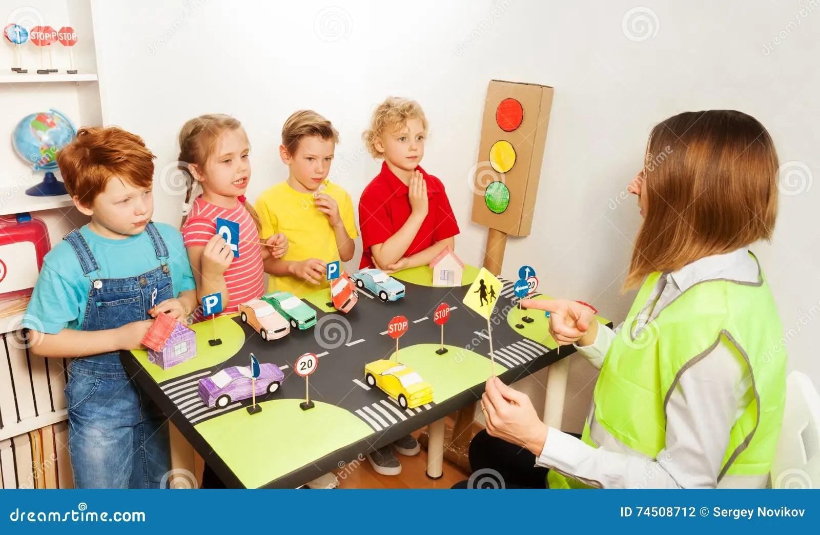 Happy Kids Teaching Traffic Signs In Kindergarten Stock