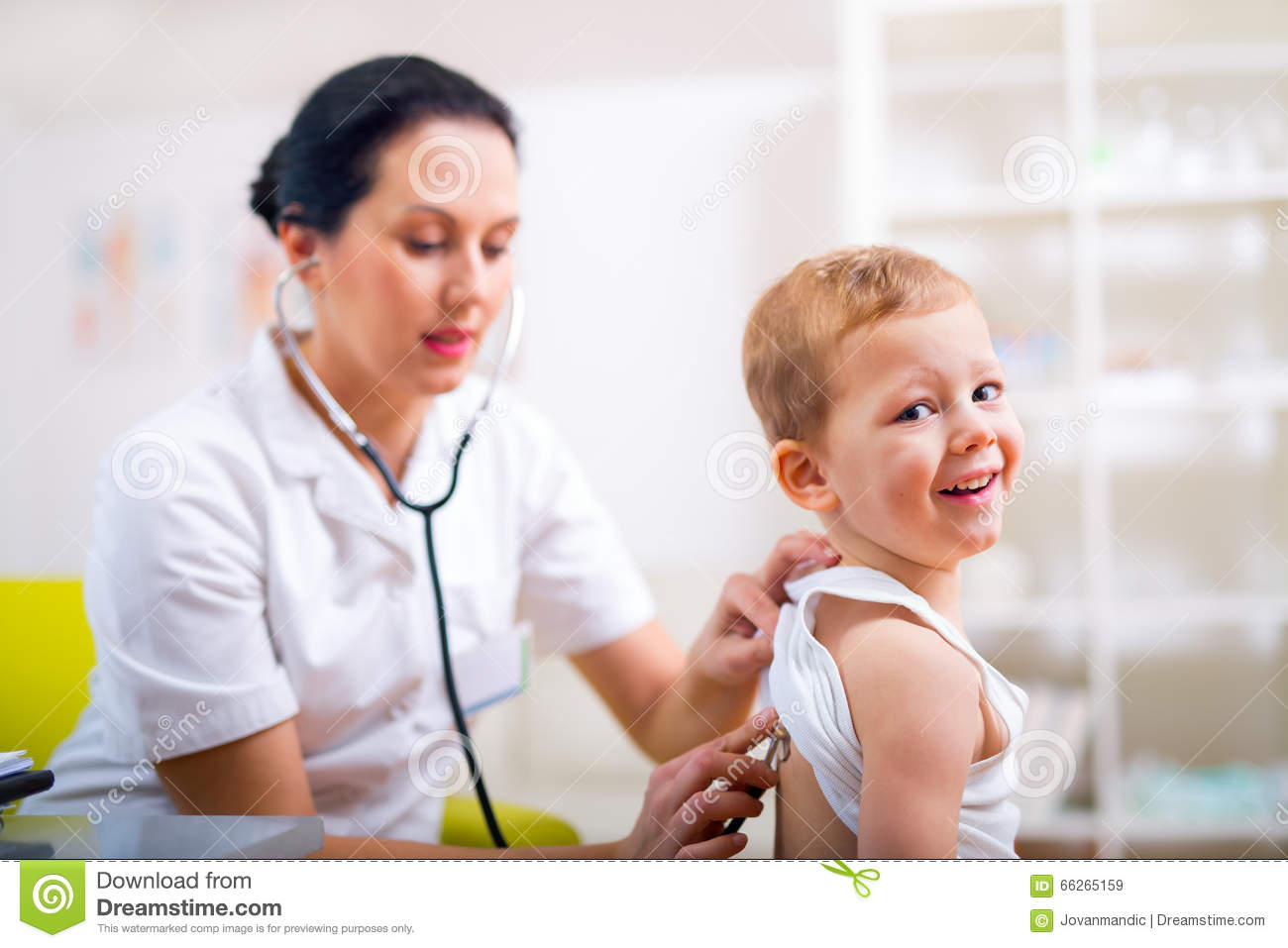 Happy Little Boy At The Doctor For A Checkup Stock Image
