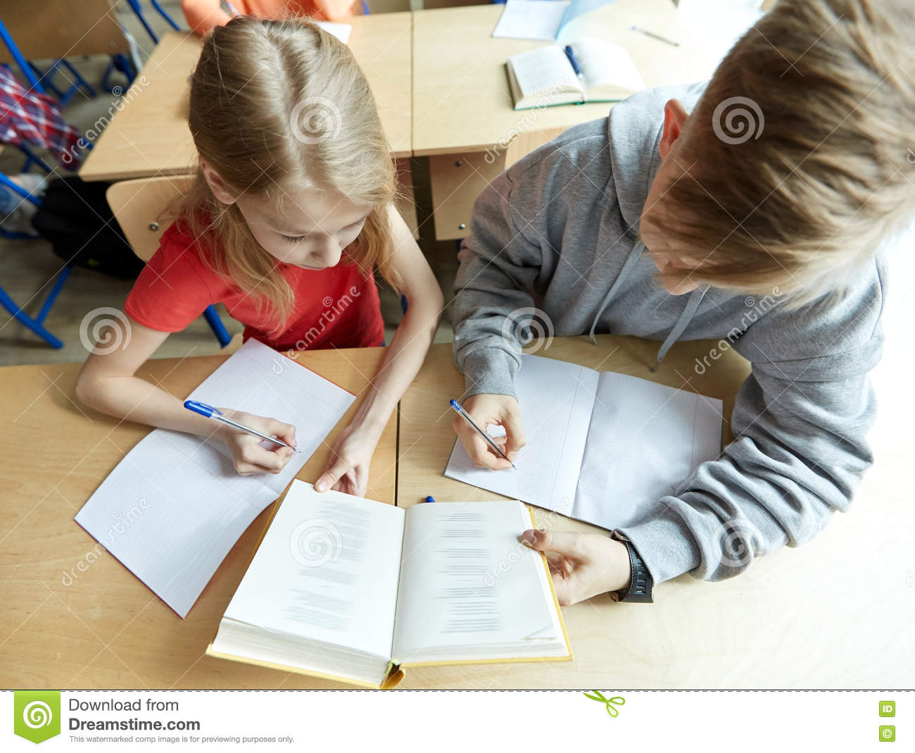 High School Students Reading Book And Learning Stock Image