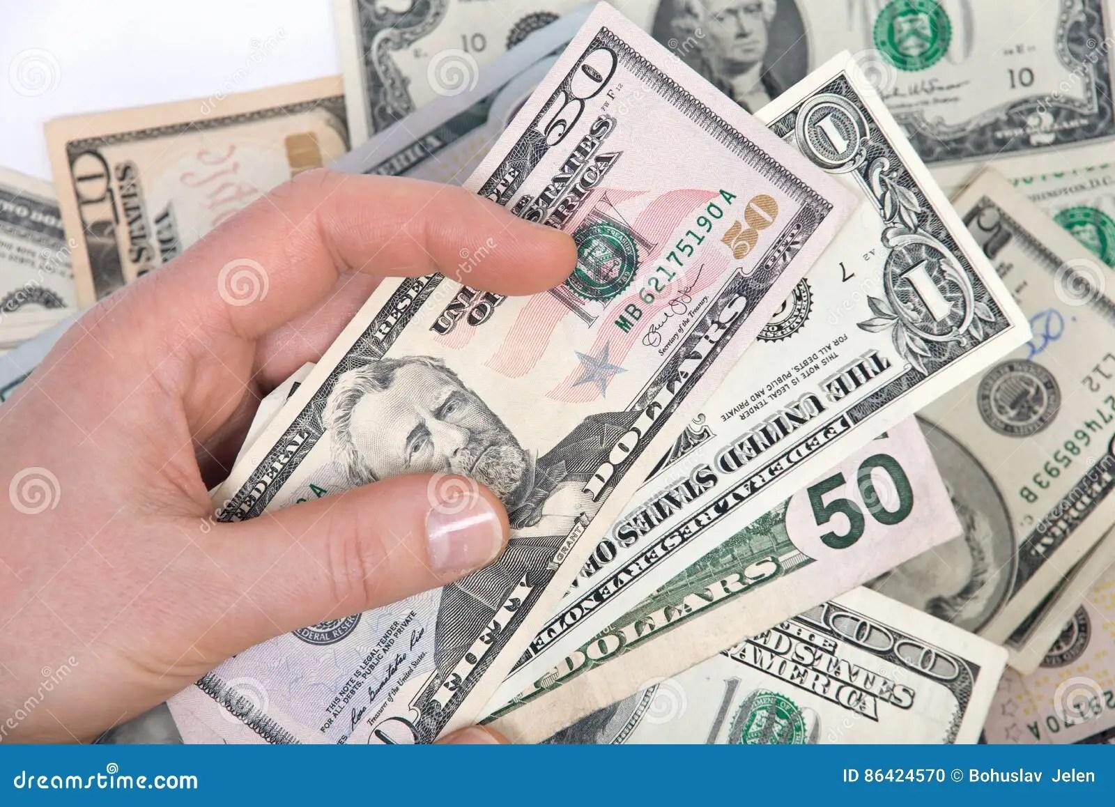 Human Hand Counting Us Dollar Bills Stock Photo