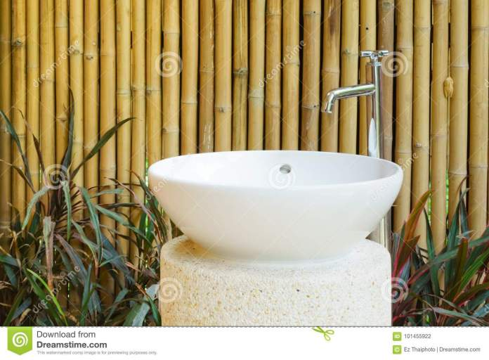 Idea Of Home Decoration Outdoor Ceramic Basin And Faucet On Bamboo Wall Background In The Garden Stock Photo Image Of Counter Decor 101455922