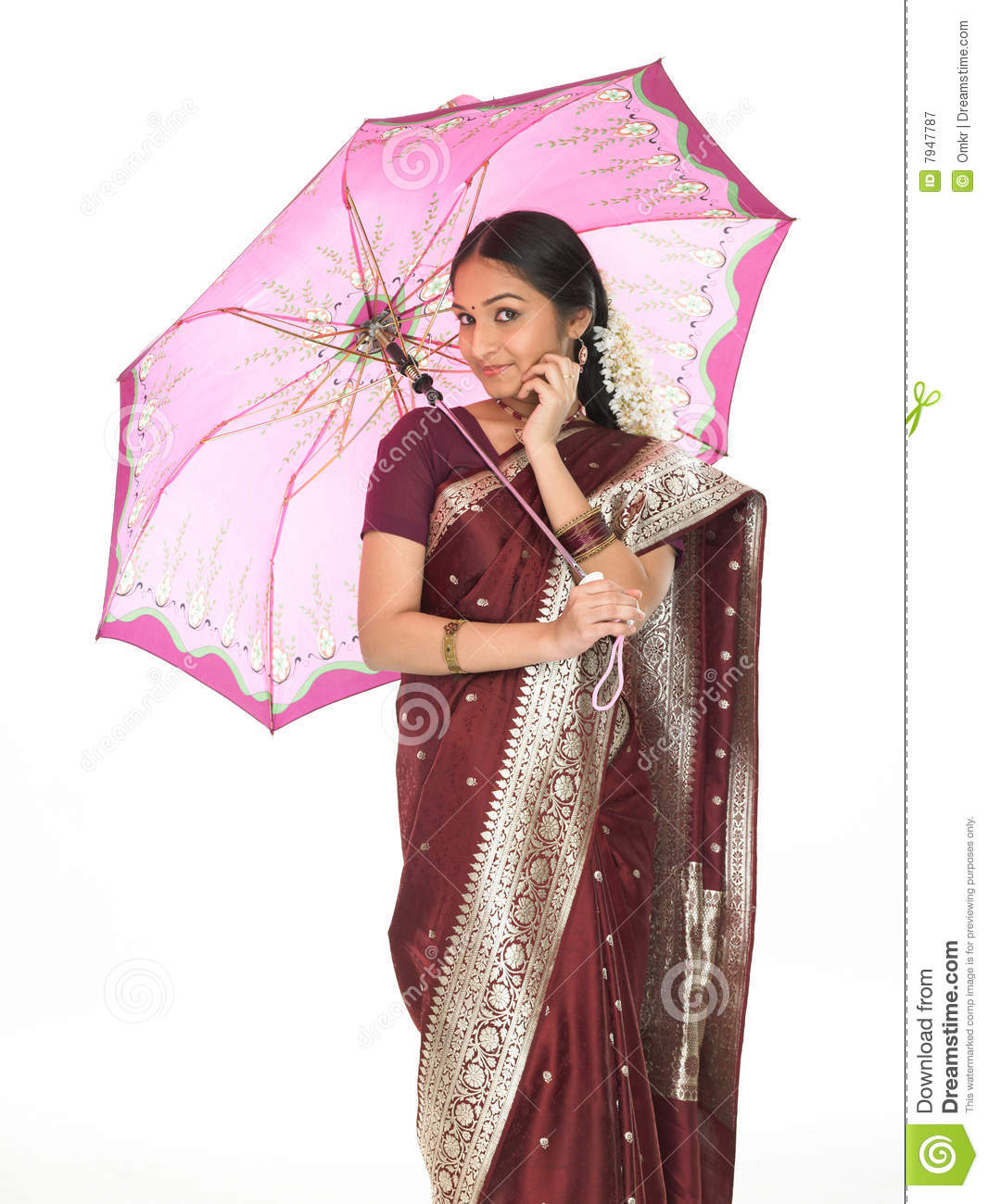 Indian Woman With Umbrella Talking Over Cell Stock Image
