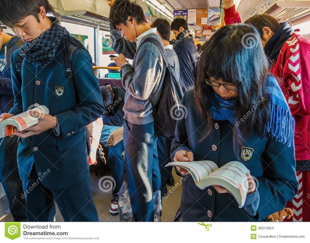 Japanese Students On A Train Editorial Stock Image