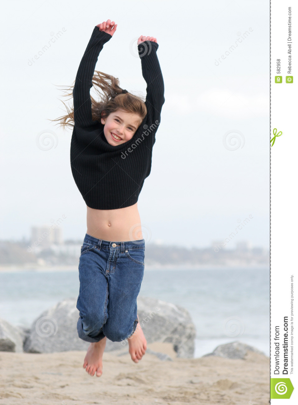 Jump For Joy Stock Photo Image Of Ocean Girl Feet Jean