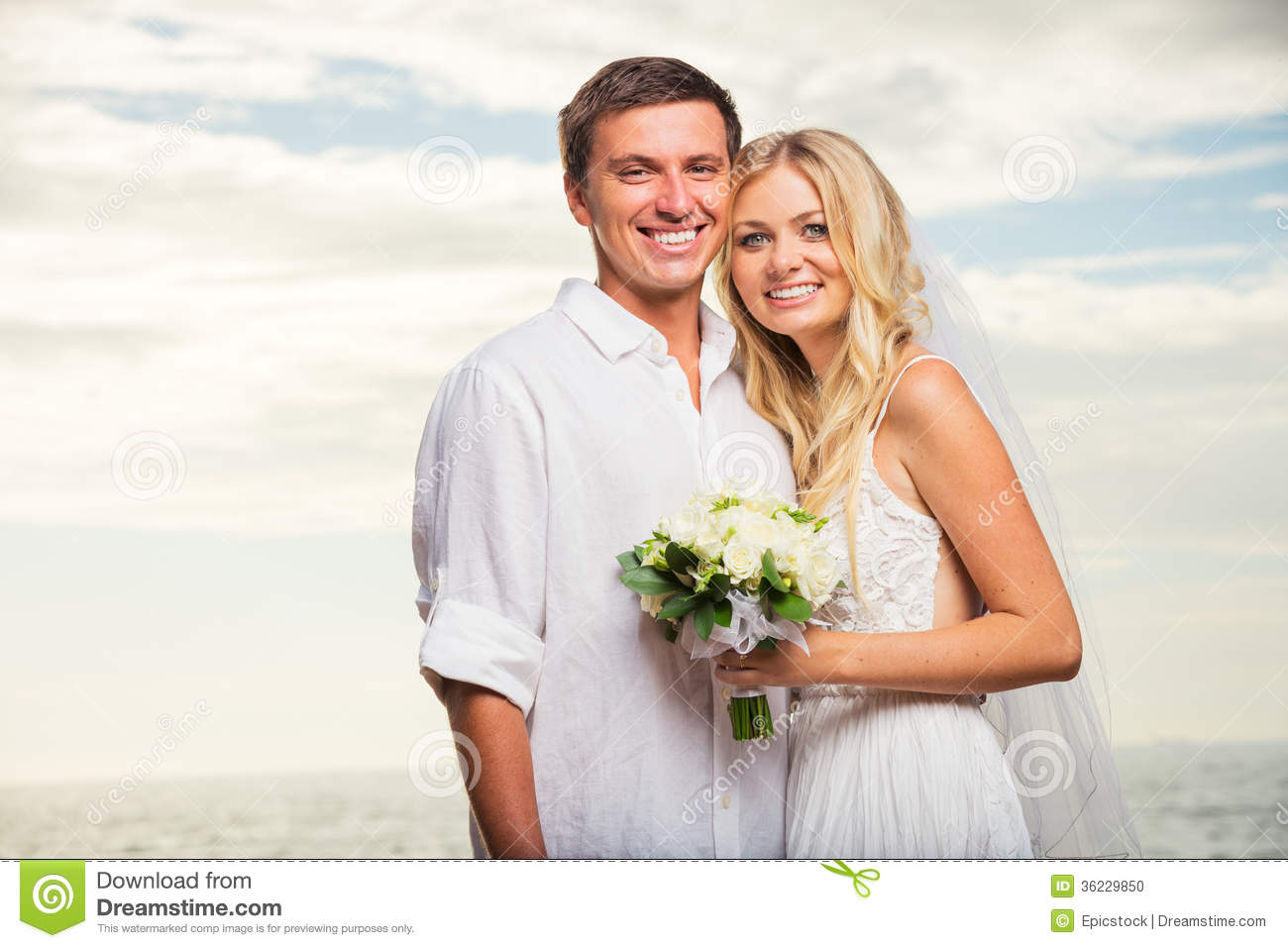 Just Married Couple On Beach At Sunset Stock Photo