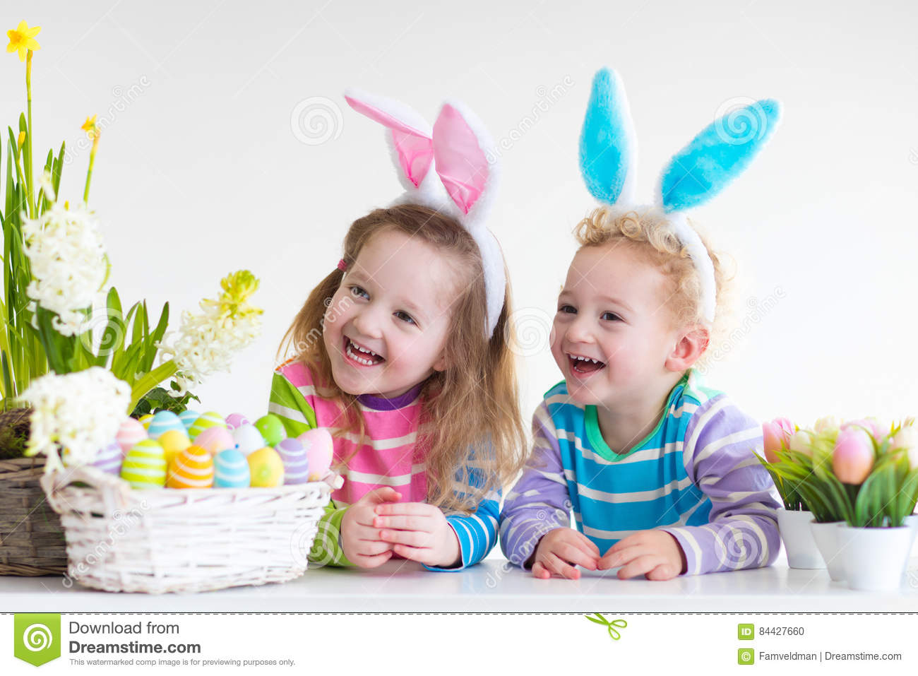 Kids With Bunny Ears On Easter Egg Hunt Stock Photo