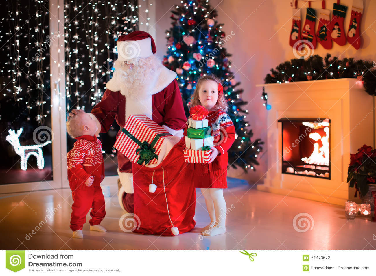 Kids And Santa Opening Christmas Presents Stock Photo