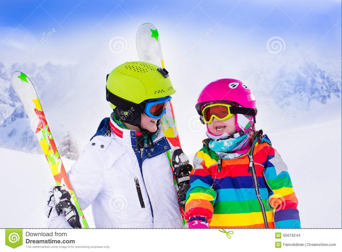 Kids Skiing In The Mountains Stock Photo