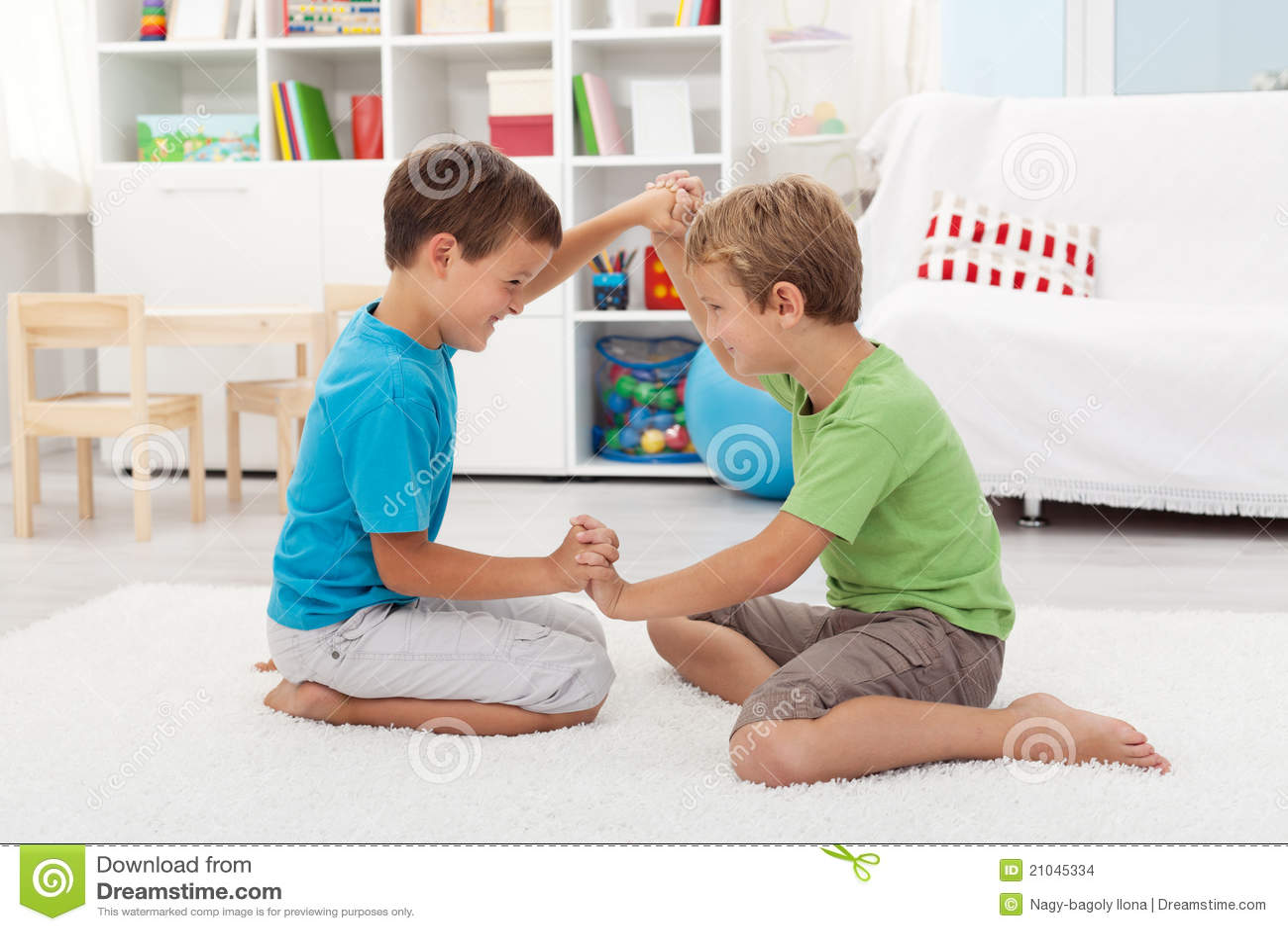 Kids Wrestling On The Floor Stock Images