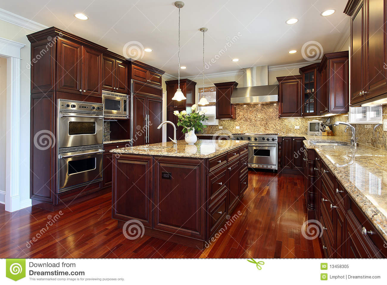 Kitchen With Cherry Wood Cabinetry Royalty Free Stock