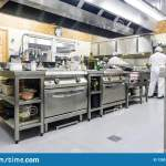 Kitchen Staff Busy With Preparing Food In Fancy Restaurant Stock Photo Image Of Kitchen Catering 128512548