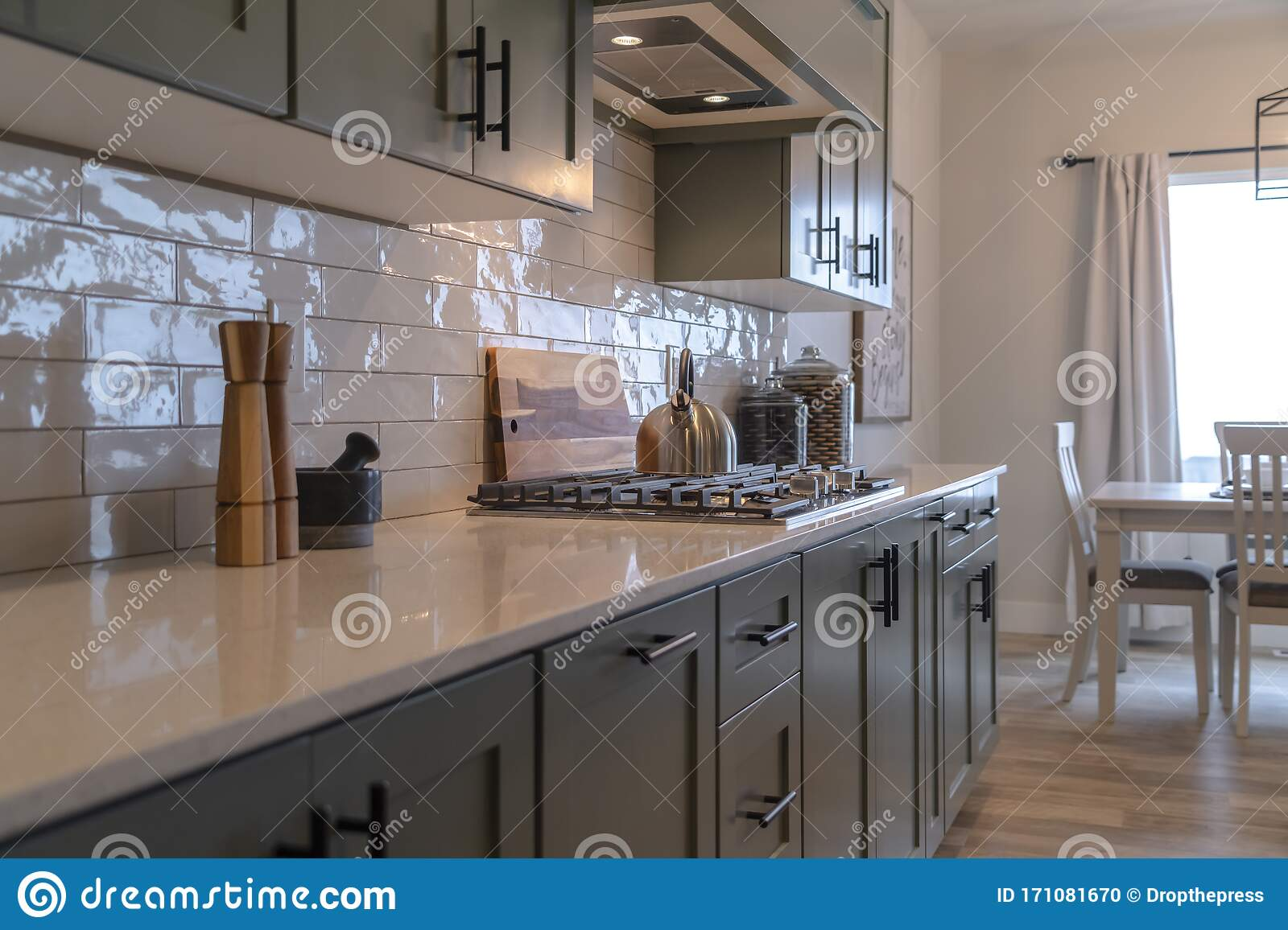 https www dreamstime com kitchen work area cabinets cooktop countertop tile backsplash dining room front large window can be seen image171081670