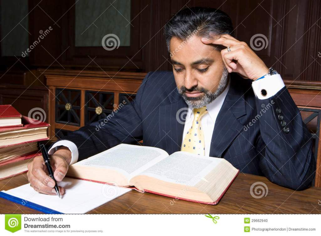 Lawyer Reading Law Book Stock Photo Image Of Illegal