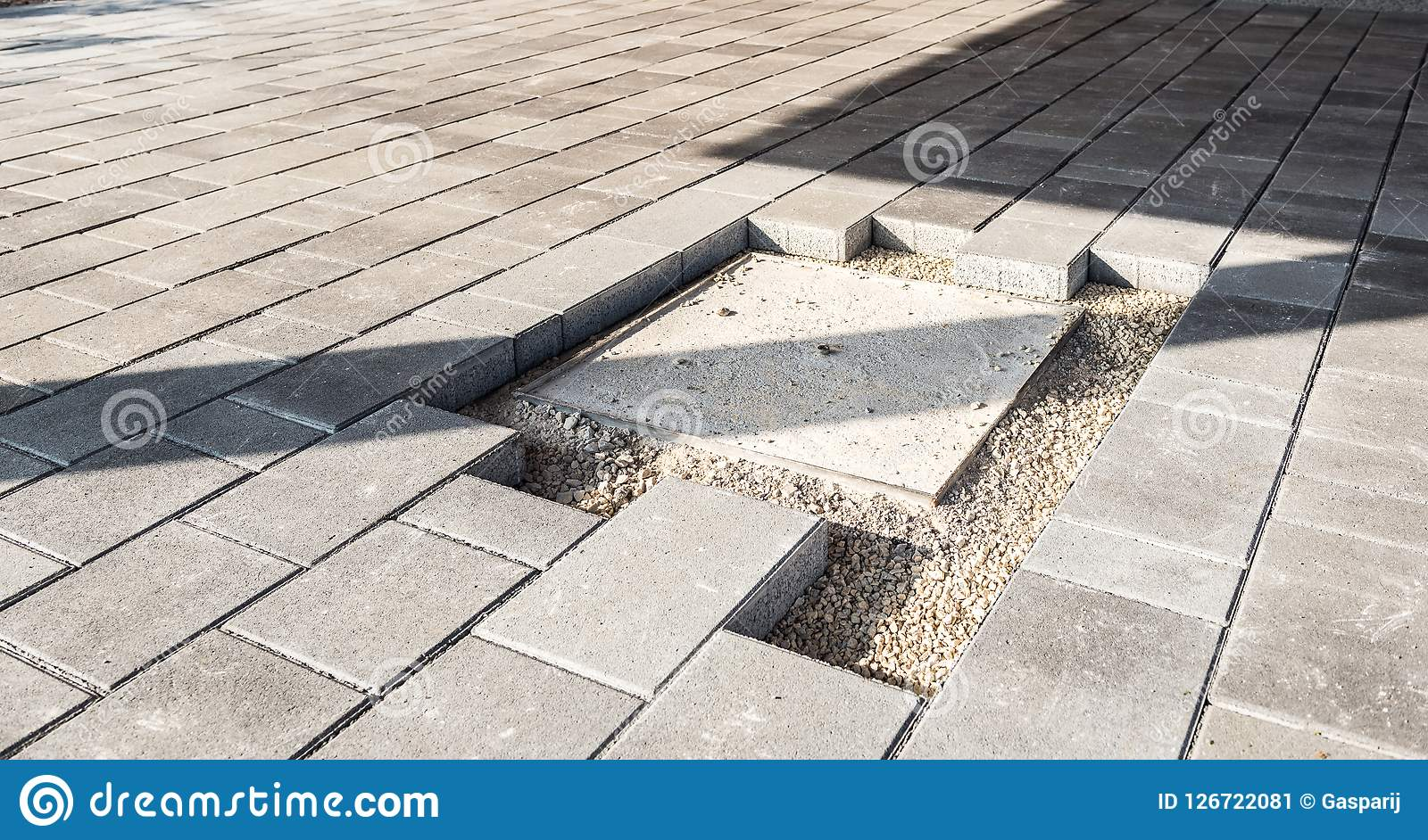 https www dreamstime com laying gray concrete paving slabs house courtyard driveway patio installing new tiles around sewer canal cover sidewalk image126722081