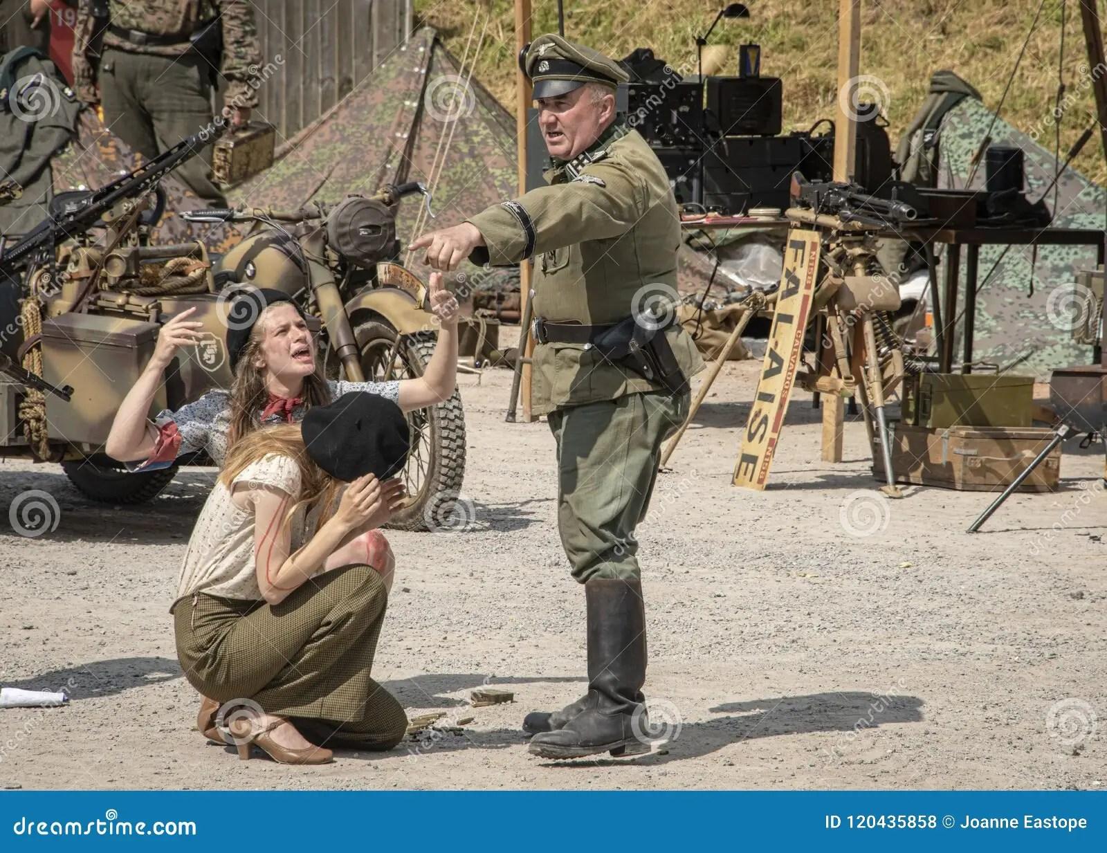 An Dressed In Ww2 German Army Uniform Threatening Female