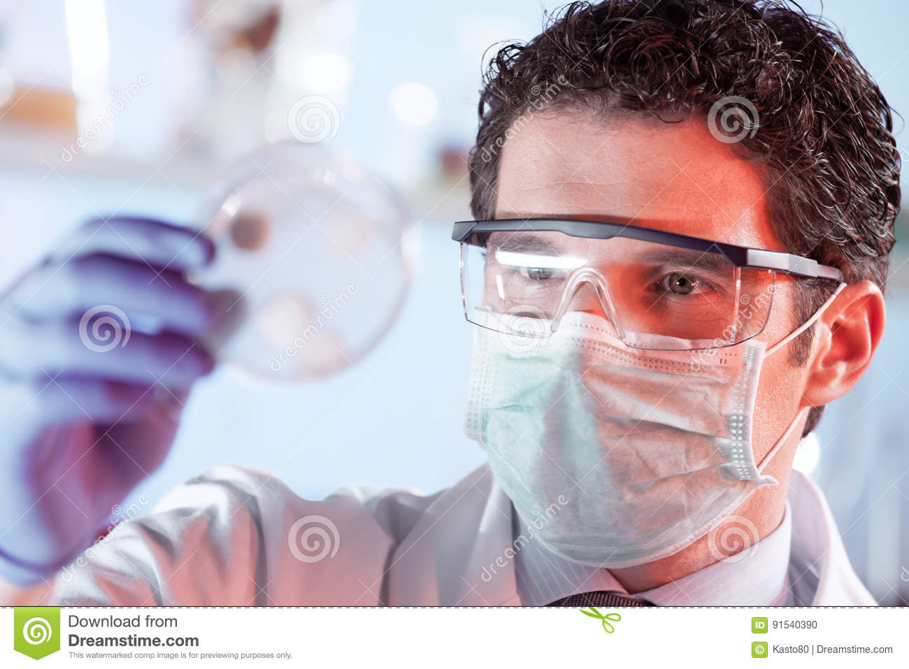 Life Science Researcher Observing Cells In Petri Dish Royalty Free Stock Image