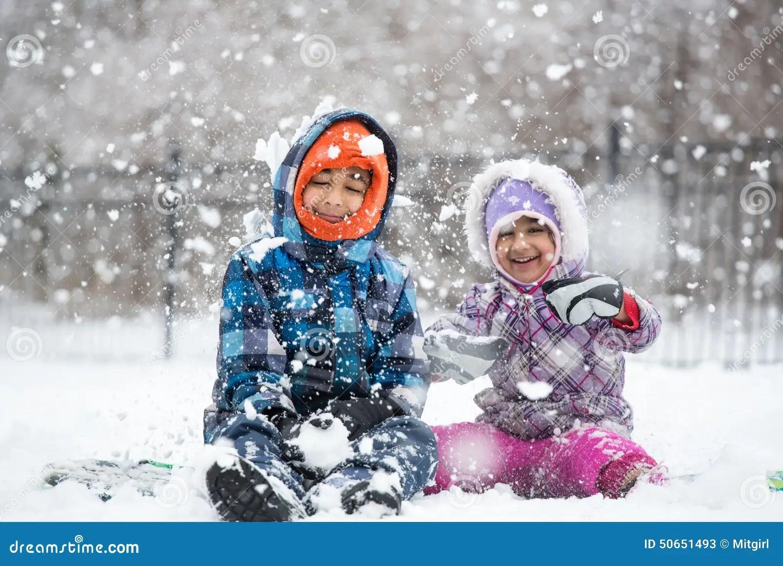 Little Children Enjoying Snowfall Stock Photo Image