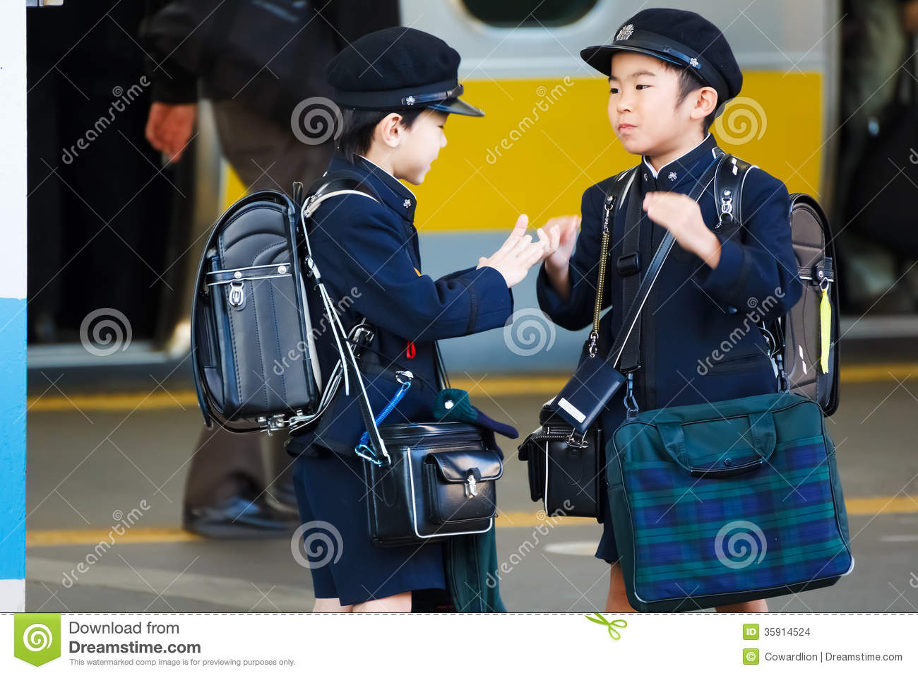 Little Japanese Student Waited For A Train To School