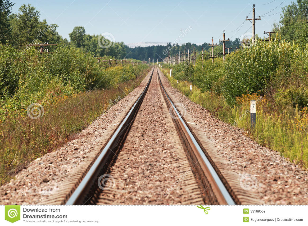 Long Straight Railway Perspective With Poles Royalty Free