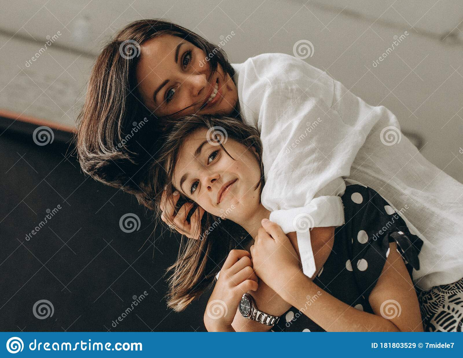 Loving Mother And Daughter Gently Hug Each Other They