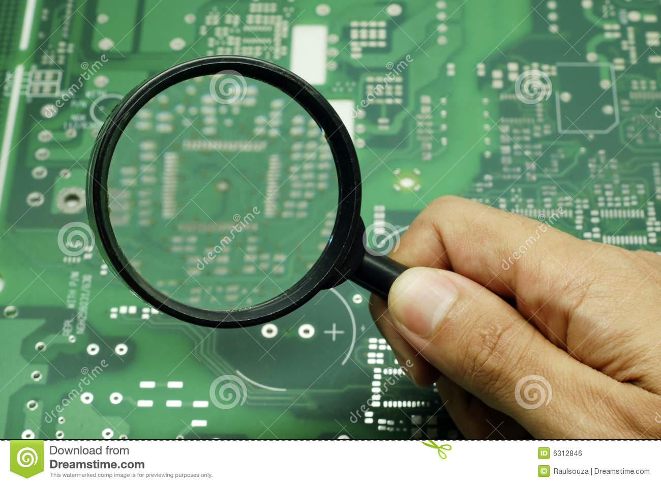 Magnifying Glass On A Circuit Royalty Free Stock Image