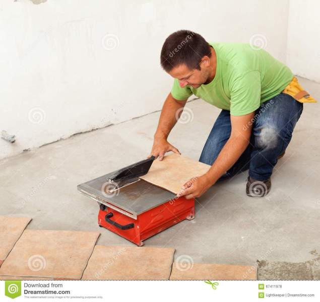 Man Cutting Ceramic Floor Tile Stock Photo   Image of repair  young     Download Man Cutting Ceramic Floor Tile Stock Photo   Image of repair   young  67411978