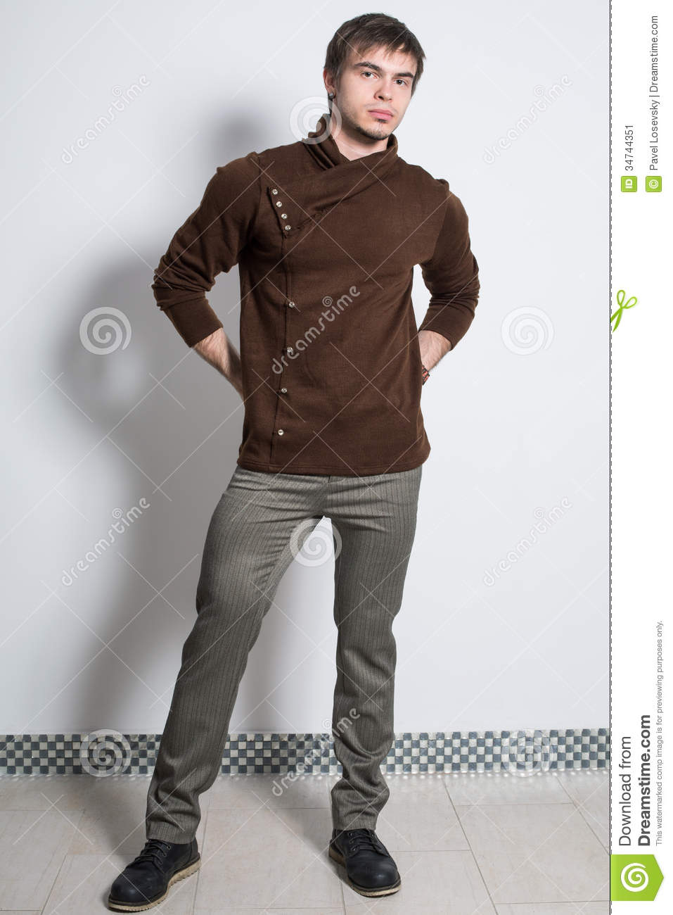 The Man In Gray Trousers And Fashionable Brown Sweater