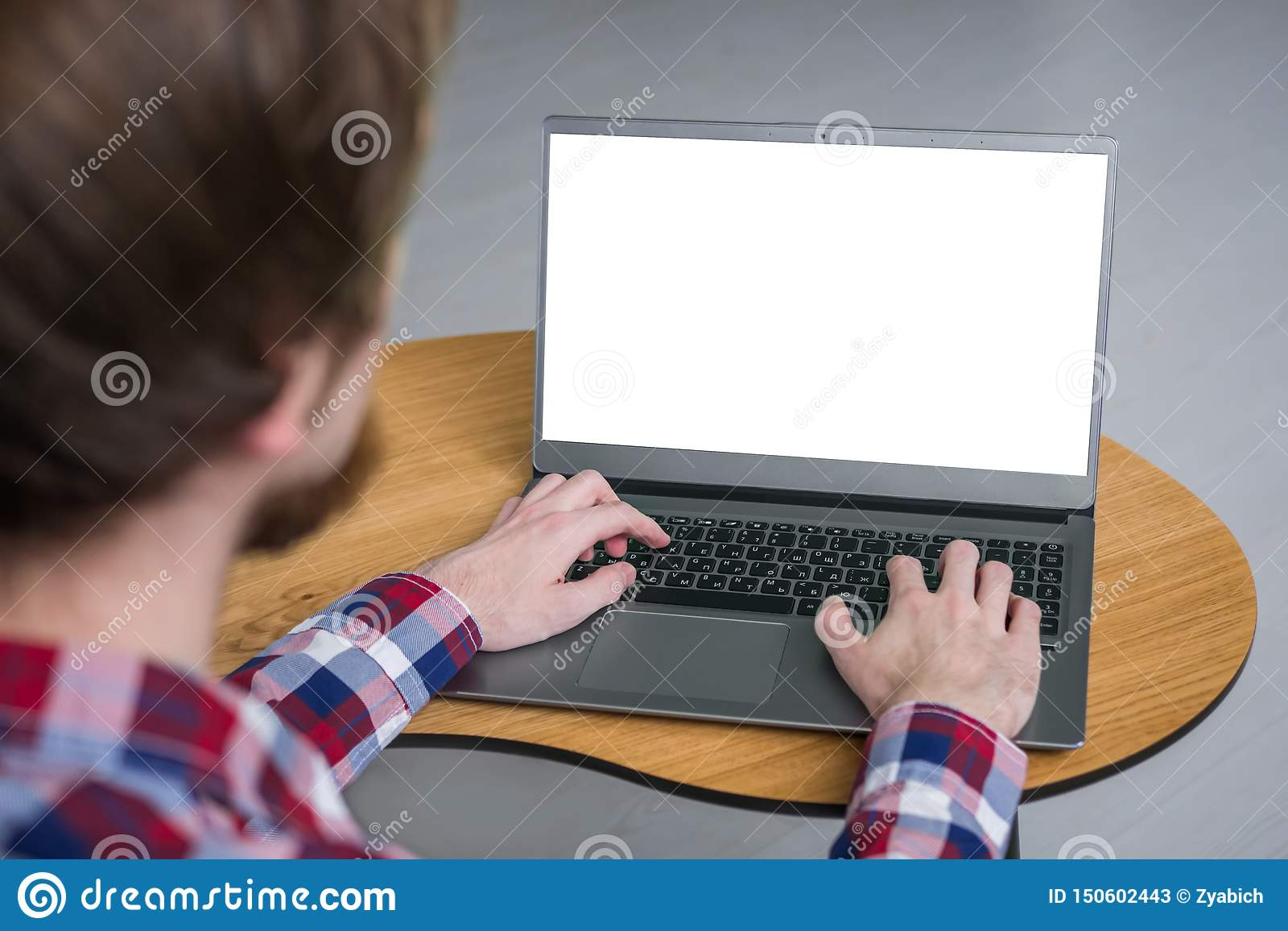 Man Hands Typing On Laptop Keyboard With White Blank