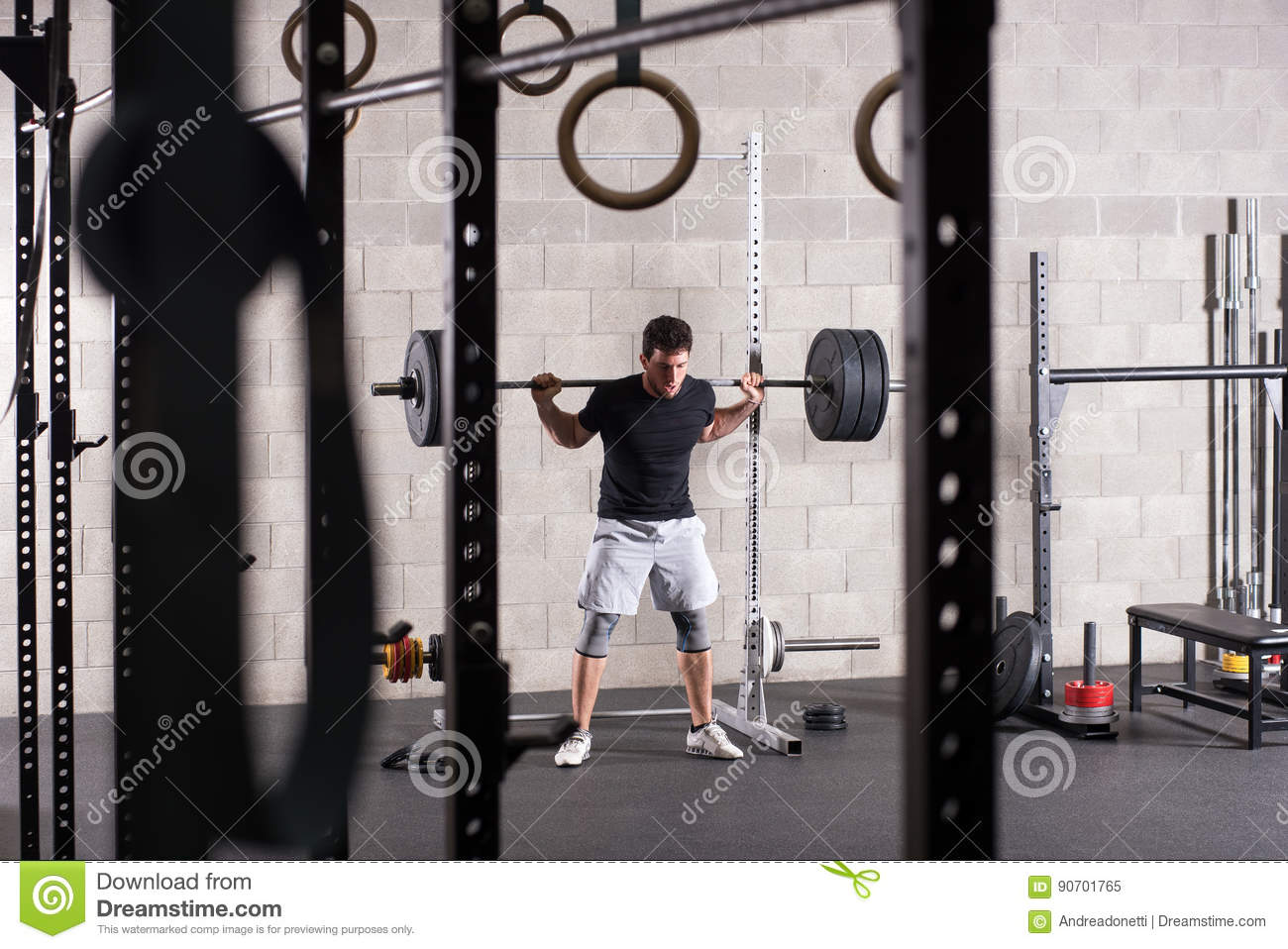 man lifting heavy barbell on squat rack stock image image of barbell athlete 90701765
