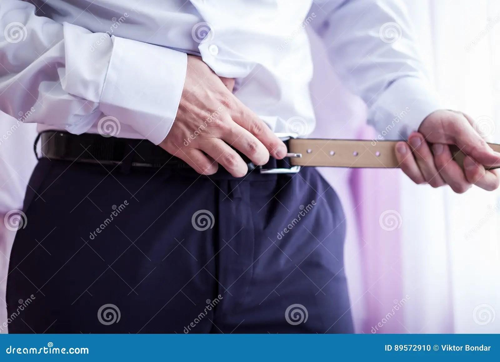 Man Putting On A Belt Mens Fashion