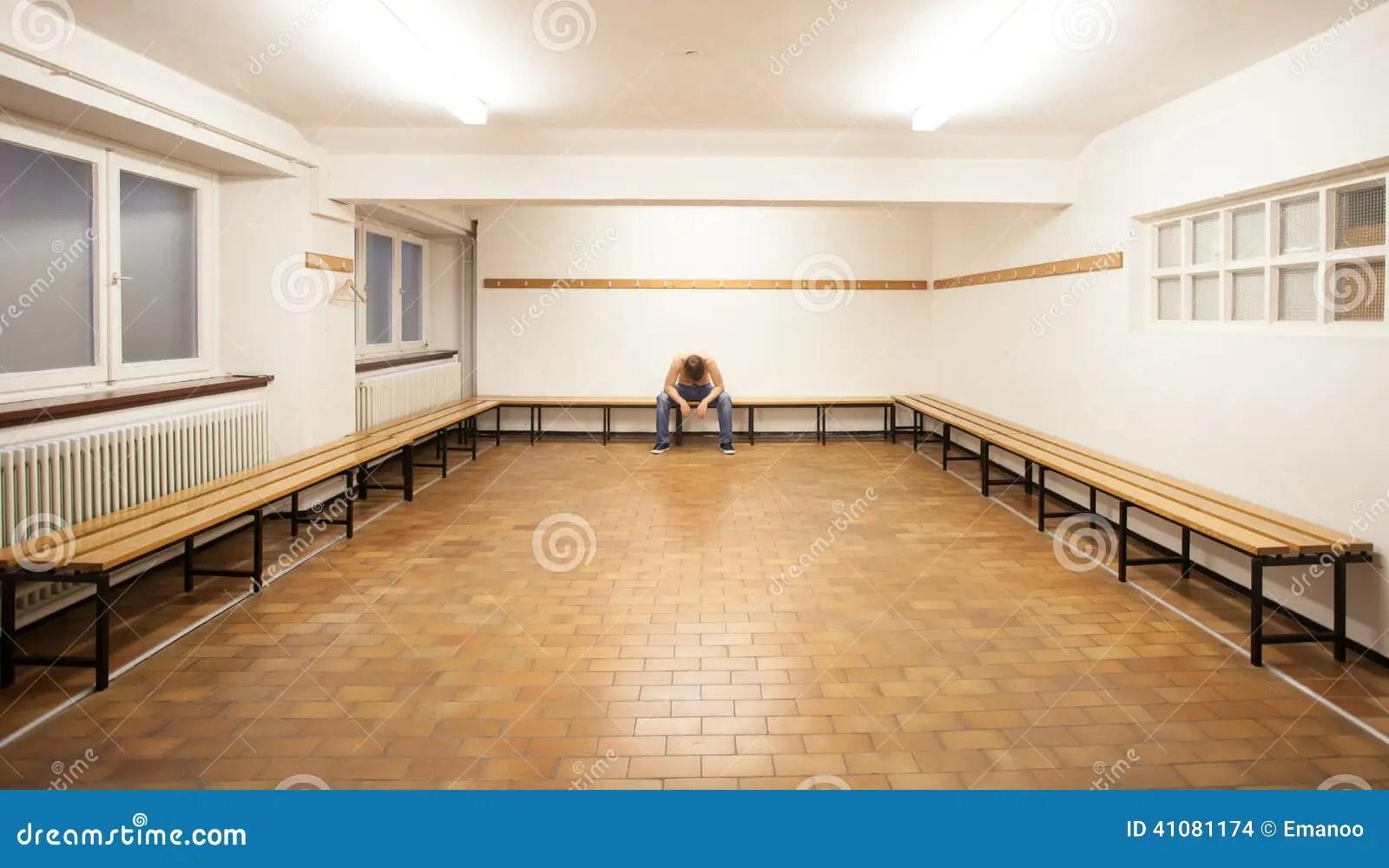 Man Sitting In Empty Locker Room Stock Photo Image 41081174