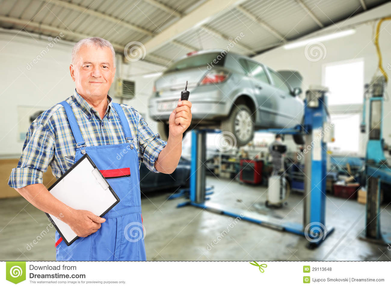Mechanic Holding A Car Key Atauto Repair Shop Stock Photo