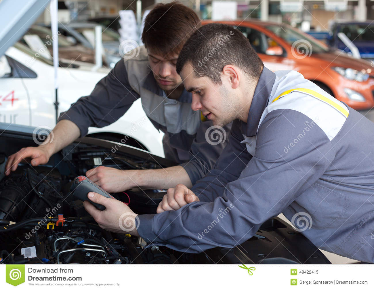 Mechanics At Repair Shop Two Confident Mechanics Working