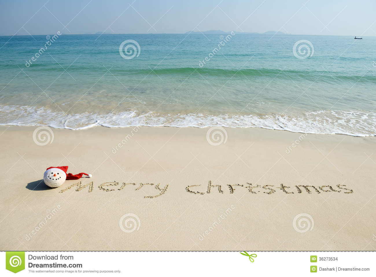 Merry Christmas Written On Tropical Beach White Sand Stock