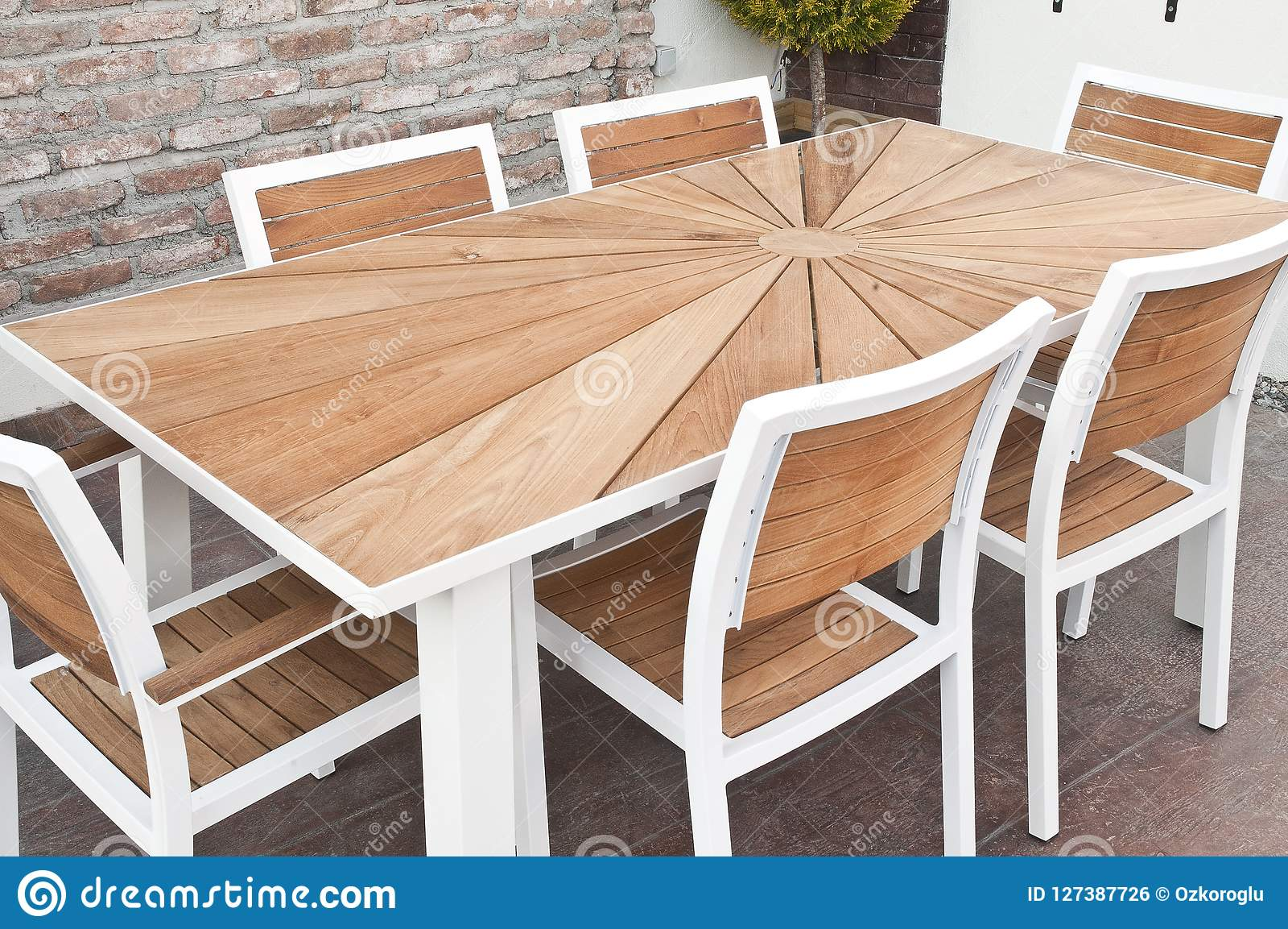 https www dreamstime com metal wood outdoor patio furniture dining table white chairs front stone wall image127387726