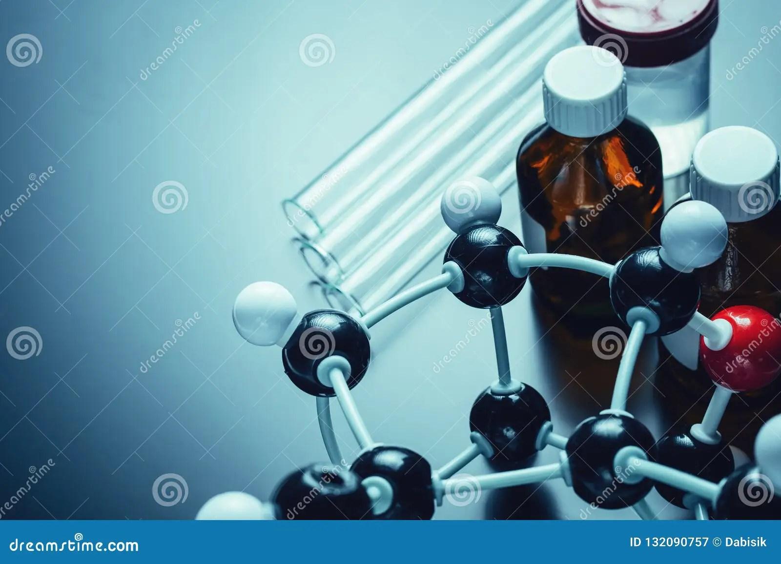 Molecular Formula And Laboratory Equipment On A Dark