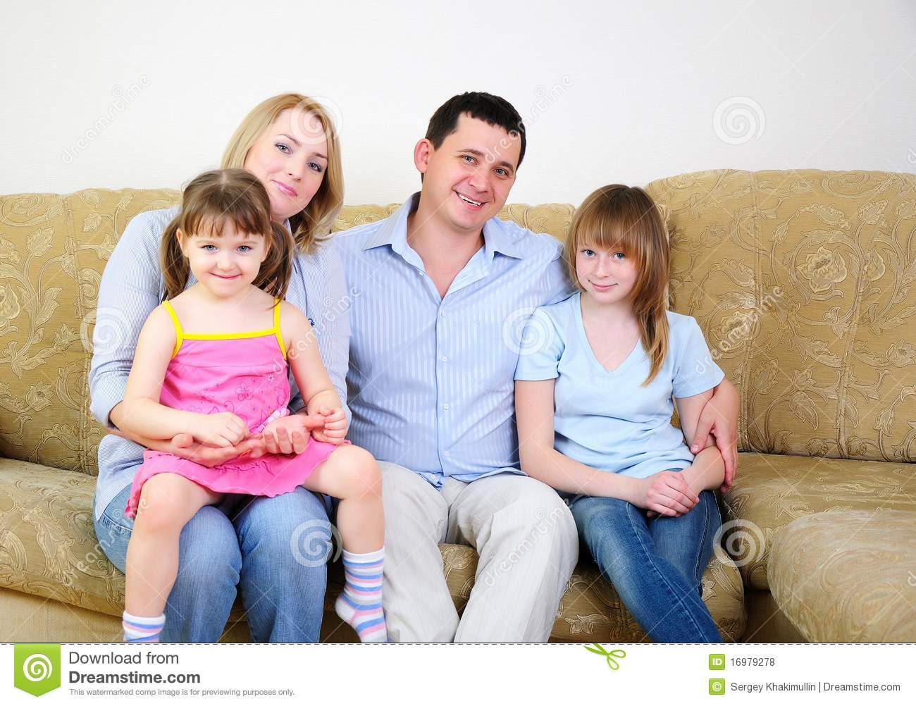 Mom Dad And Their Two Daughters Stock Photo
