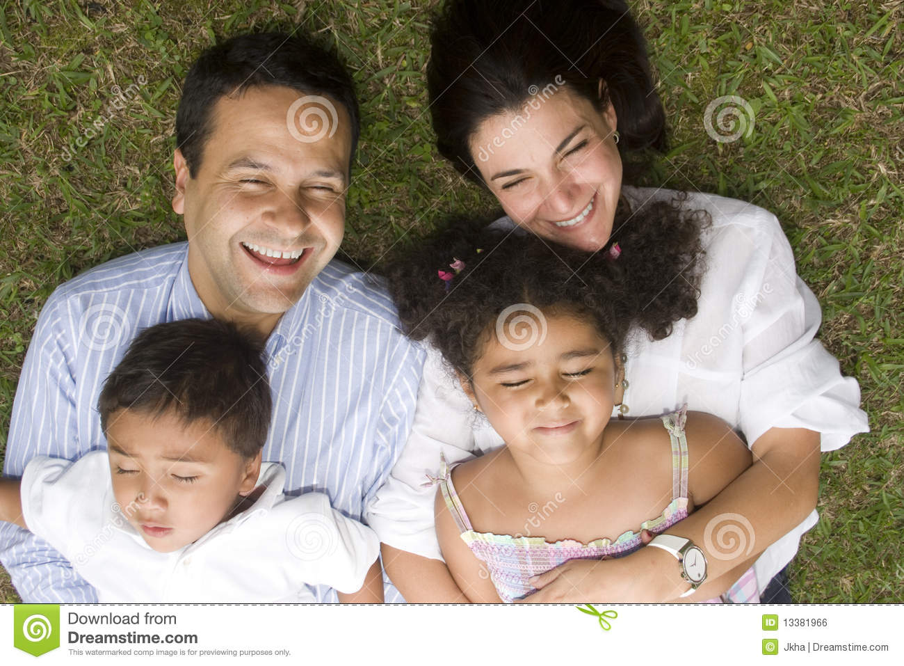 Mom And Dad Walking With Their Children Stock Photo