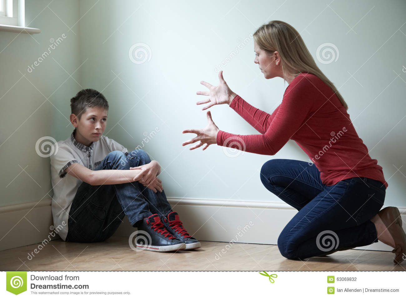 Mother Being Physically Abusive Towards Son Stock Photo
