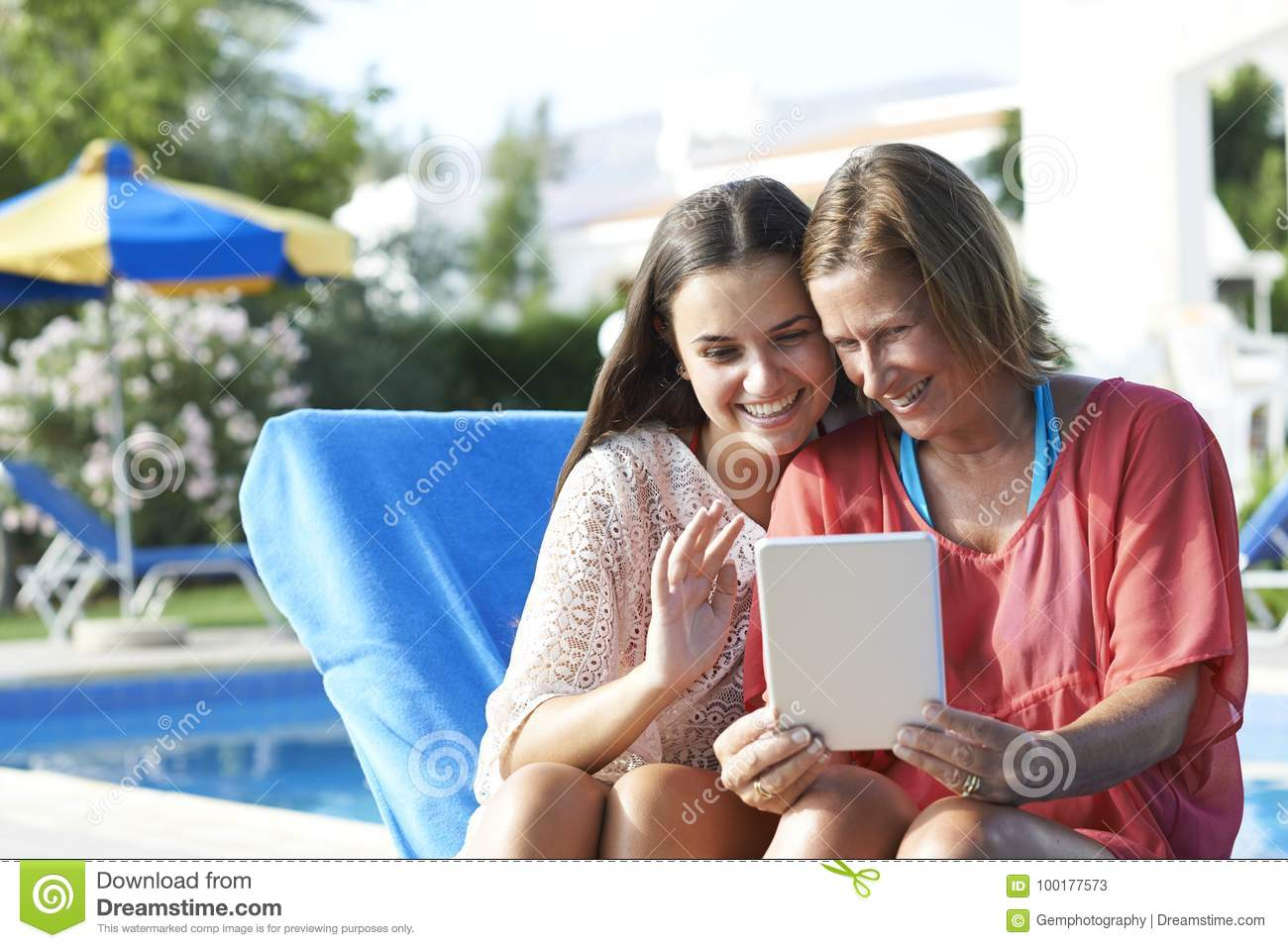 Mother And Daughter Skpying On Digital Tablet Stock Image