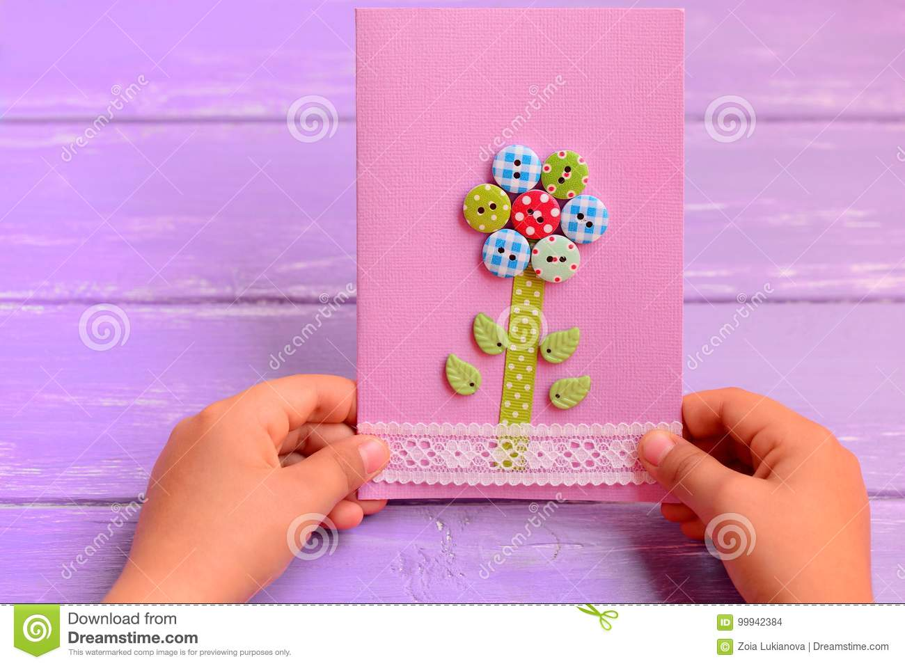 Child Holds A Flower Card In His Hands Child Made A Greeting Card For Mom Or Dad Birthday Mothers Day Fathers Day Gift Idea Stock Photo Image Of Card Mothers 99942384