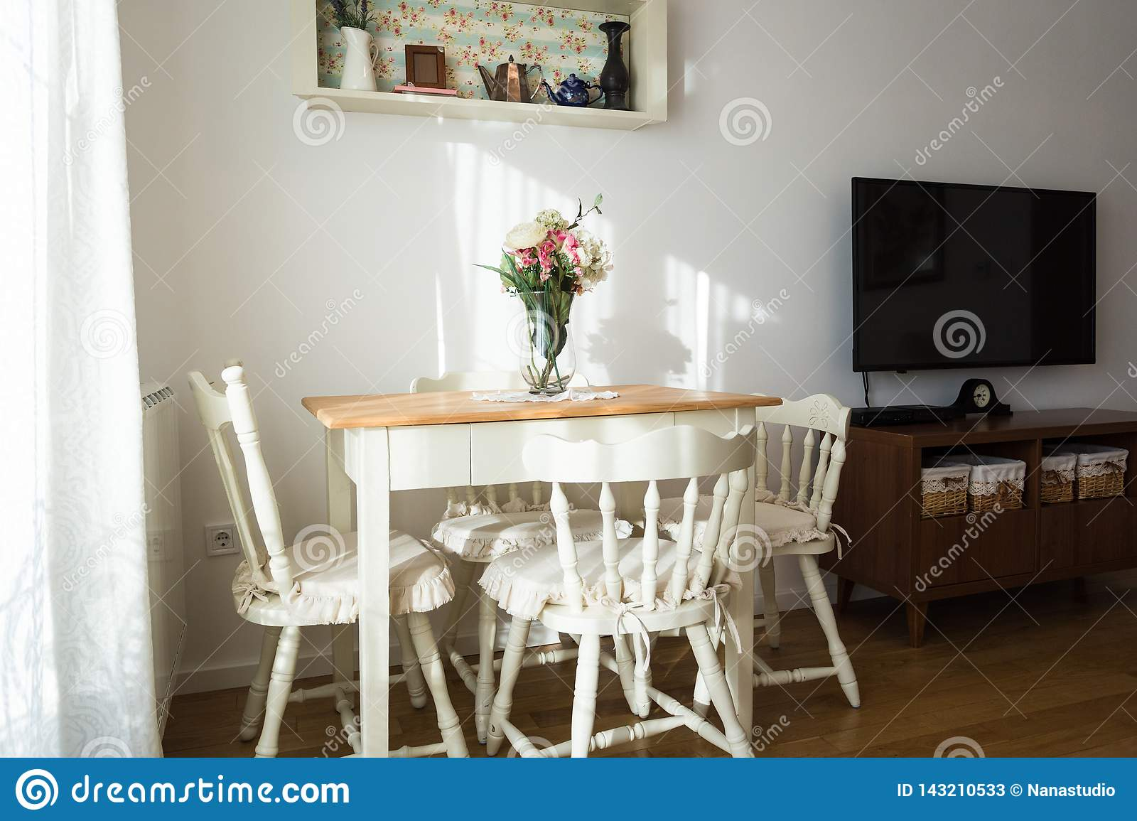 Nicely Decorated Living Room Dining Table And Some Chairs