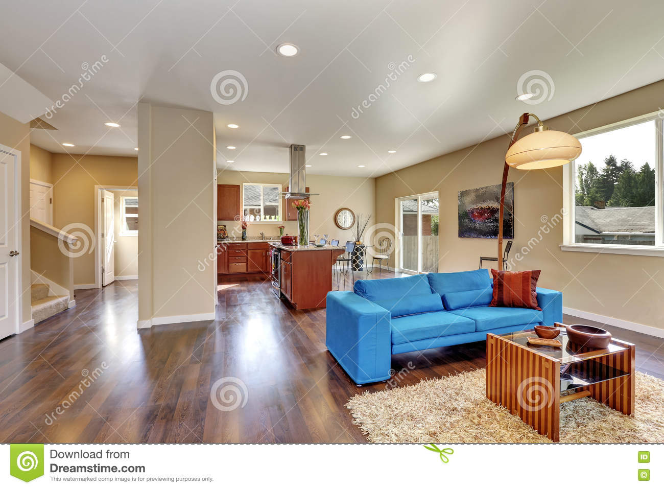 Nicely Decorated Living Room Interior With Bright Blue Sofa